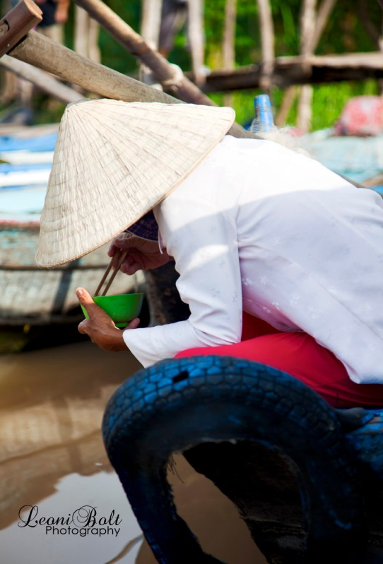 vietnamese woman in cone hat