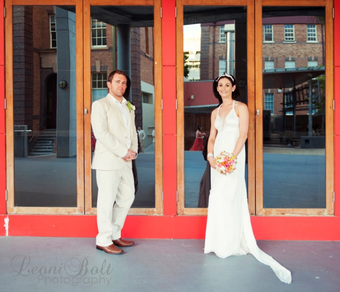 wedding couple in red doorway at QUT